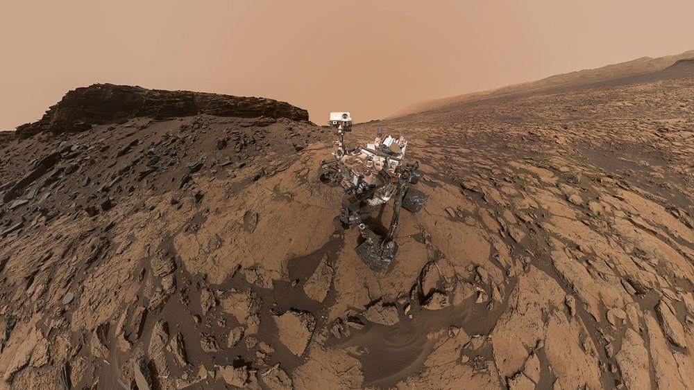 Panoramic image of the Curiosity rover, from September 2016. The pale outline of Aeolis Mons can be seen in the distance. - Image Credit: NASA/JPL-Caltech/MSSS