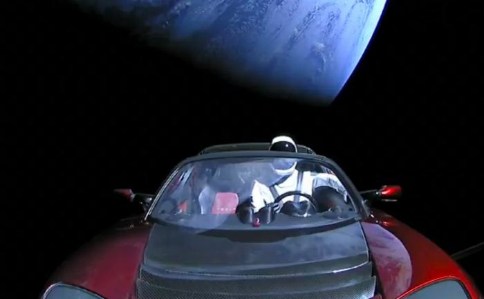 StarMan drives his Tesla to space. - Image Credit: SpaceX