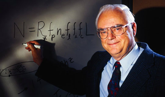 Frank Drake writing his famous equation on a white board. - Image Credit: SETI.org