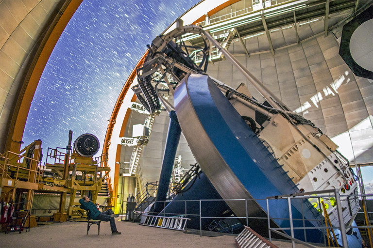 The DECam in operation at its home in the Chilean Andes. The extremely sensitive, 570 megapixel camera is mounted on the Victor M. Blanco 4-meter Telescope at the Cerro Tololo Inter-American Observatory. - Image Credit: DES/CTIO