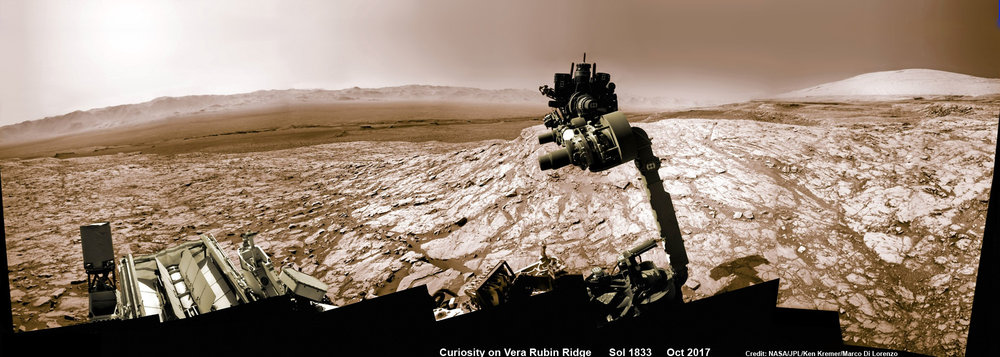 NASA's Curiosity rover raised robotic arm with drill pointed skyward while exploring Vera Rubin Ridge at the base of Mount Sharp inside Gale Crater – backdropped by distant crater rim. - Image Credit: NASA/JPL/Ken Kremer/kenkremer.com/Marco Di Lorenzo