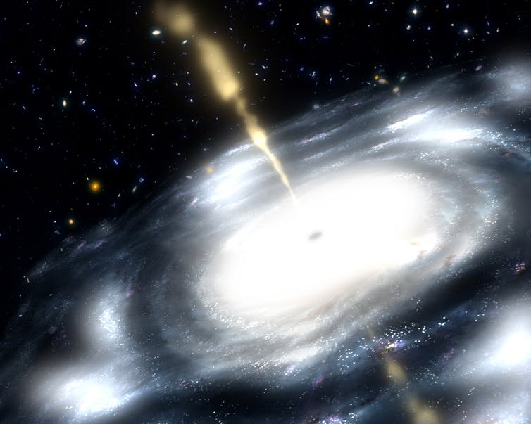 Artist's concept shows a galaxy with a supermassive black hole at its core. - Image Credit: NASA