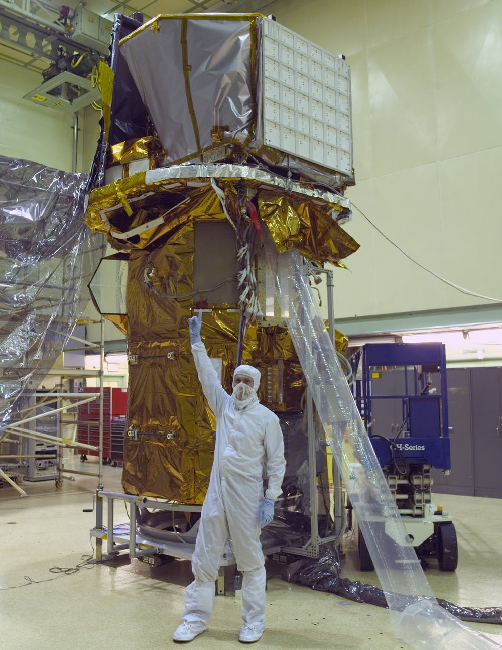 Neil Gehrels in the cleanroom with the Swift telescope while under construction. - Image Credit:  NASA ,  CC BY