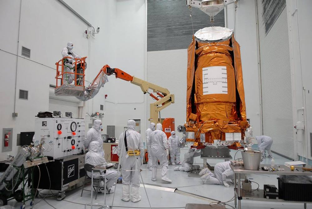 Prepping the Kepler spacecraft pre-launch in 2009. - Image Credit:  NASA/Tim Jacobs ,  CC BY