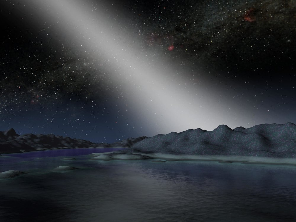 This artist's illustration shows what the sky might look like from a planet in a particularly dusty solar system. Dust that orbits a star in the plane of the solar system is called zodiacal dust, and the light reflected and scattered by that dust is called zodiacal light. The Hunt for Observable Signatures of Terrestrial Systems, or HOSTS, survey was tasked with learning more about the effect of zodiacal dust on the search for new worlds, to help guide the design of future planet-hunting missions. - Image Credits: NASA/JPL-Caltech