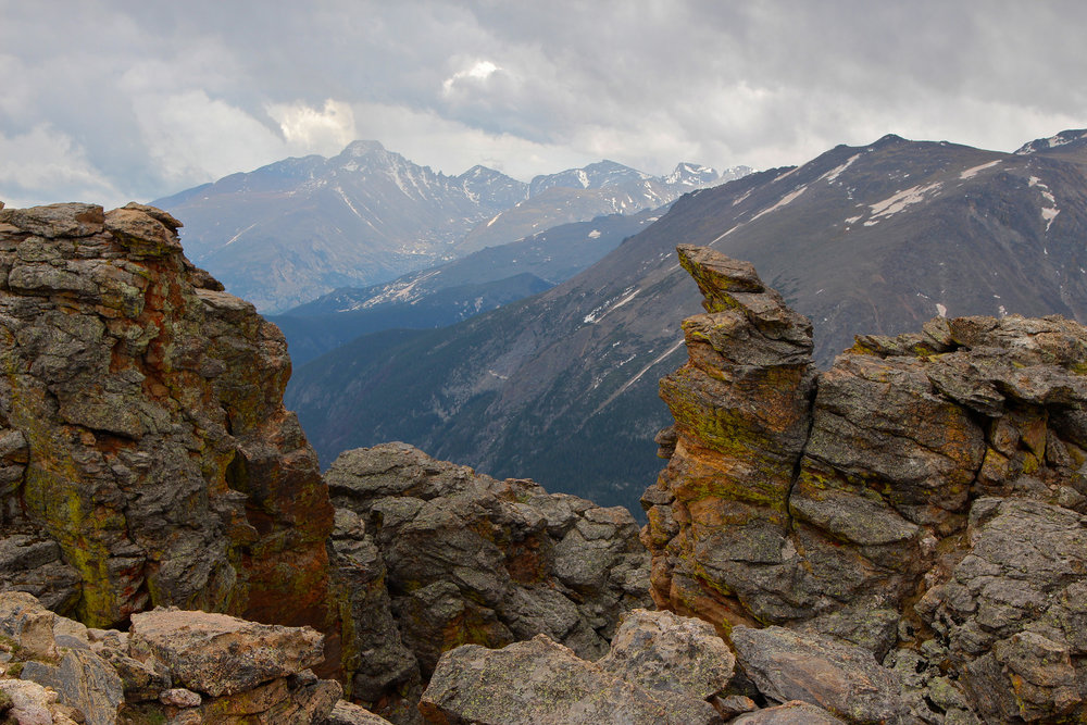 Long's Peak framed by rock outcrop, Rocky Mountain National Park, Colorado. - Image Credit: Roy Luck , CC BY