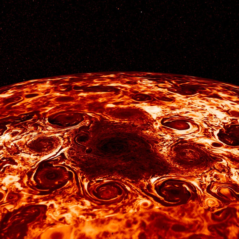 Jupiter's northern cyclones in infrared, which captures the radiating heat. In this original image, darker regions are colder and cloudier, while brighter regions are relatively cloud-free, allowing us to look deeper. - Image Credit: NASA/JPL-Caltech/SwRI/ASI/INAF/JIRAM