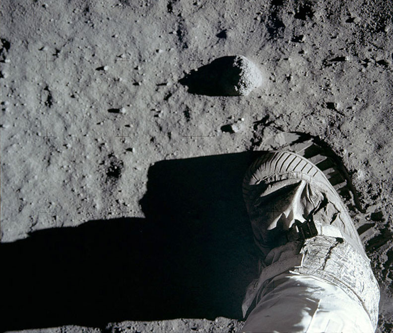 After taking the first boot print photo, Aldrin moved closer to the little rock and took this second shot. The dusty, sandy pebbly soil is also known as the lunar 'regolith'. - Image Credit: NASA