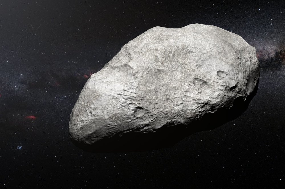 This artist's impression shows the exiled asteroid 2004 EW95, the first carbon-rich asteroid confirmed to exist in the Kuiper Belt and a relic of the primordial Solar System. This curious object likely formed in the asteroid belt between Mars and Jupiter and must have been transported billions of kilometres from its origin to its current home in the Kuiper Belt. - Image Credit: ESO/M. Kornmesser