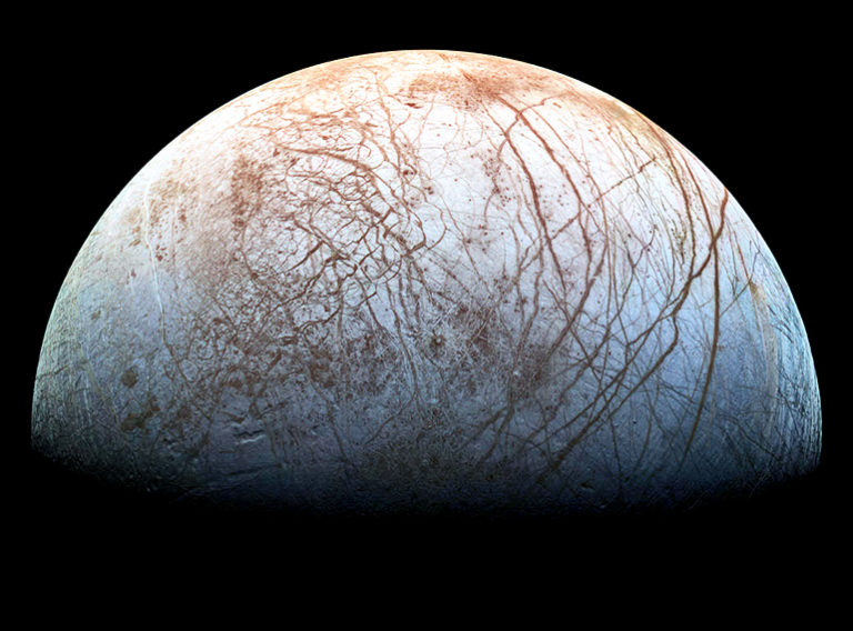 The puzzling, fascinating surface of Jupiter's icy moon Europa looms large in this newly-reprocessed color view, made from images taken by NASA's Galileo spacecraft in the late 1990s. - Image Credit: NASA