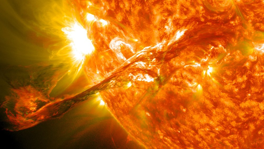 Artist's impression of a solar flare erupting from the Sun's surface. - Image Credit: NASA Goddard Space Flight Center