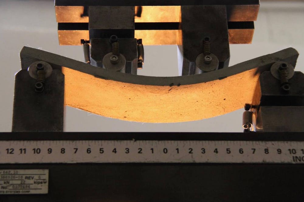 Unlike conventional concrete, engineered cementitious composite (ECC) can bend under pressure without rupturing. - Image Credit: Victor Li, CC BY-ND