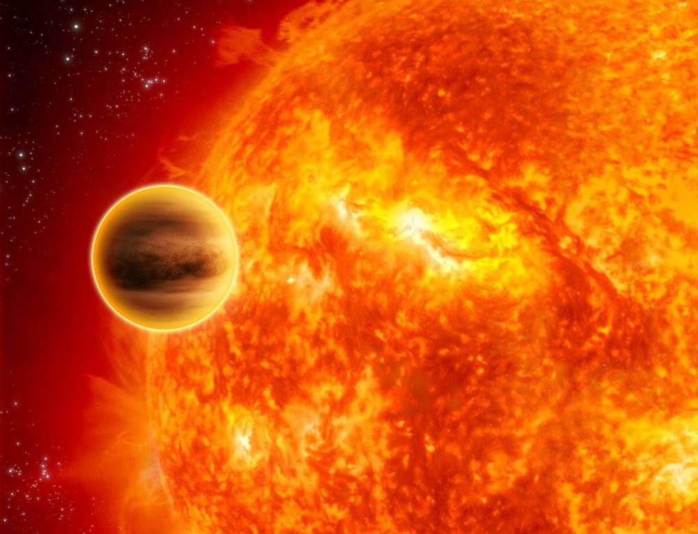 An exoplanet transiting across the face of its star, demonstrating one of the methods used to find planets beyond our solar system. - Image Credit: ESA/C. Carreau