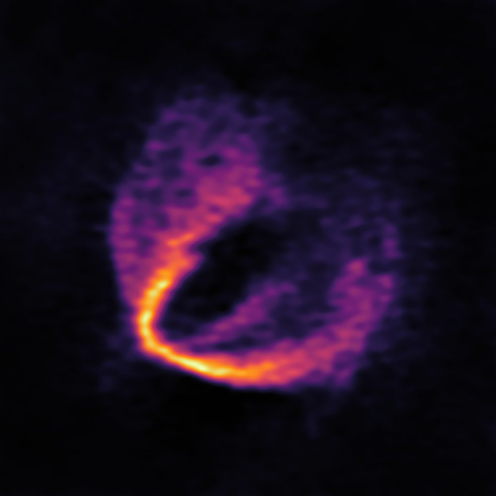 "This image shows part of the ALMA data set at one wavelength and reveals a clear ""kink"" in the material, which indicates unambiguously the presence of one of the planets. - Image Credit: ESO, ALMA (ESO/NAOJ/NRAO); Pinte et al."