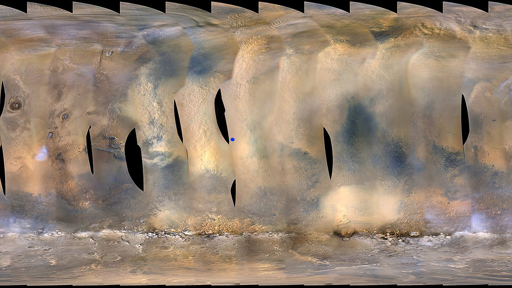This global map of Mars shows a growing dust storm as of June 6, 2018. The map was produced by the Mars Color Imager (MARCI) camera on NASA's Mars Reconnaissance Orbiter spacecraft. The blue dot indicates the approximate location of Opportunity. - Image Credit: NASA/JPL-Caltech/MSSS