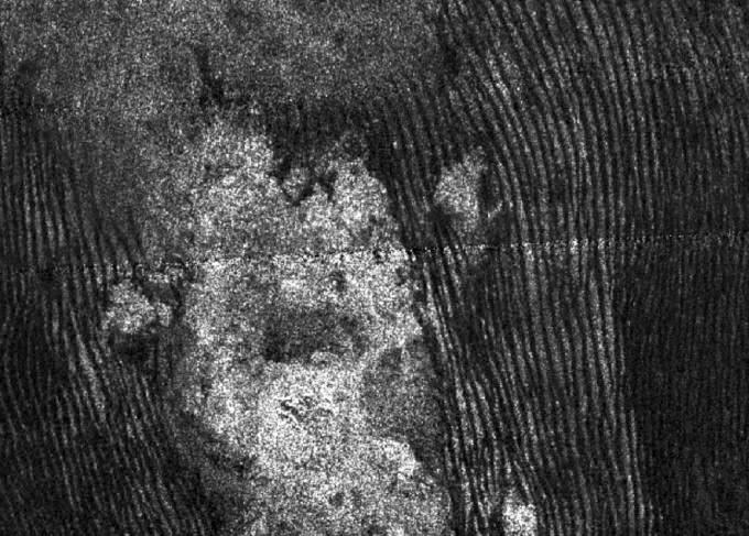 Radar image of sand dunes on Titan. - Image Credit: NASA/JPL–Caltech/ASI/ESA and USGS/ESA