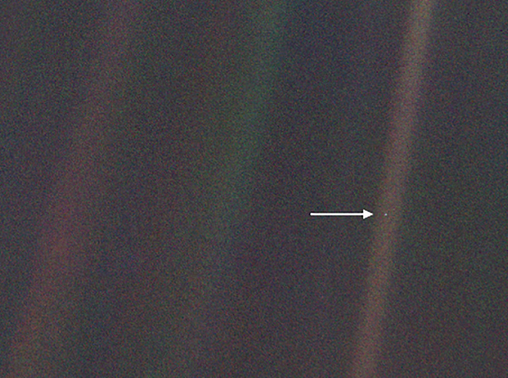 "This image, taken by NASA's Voyager 1 spacecraft from beyond the orbit of Neptune, shows planet Earth as seen from about 3.7 billion miles (5.9 billion km) away. Earth appears as a very small point of light in the right half of the image, indicated by an arrow. Dubbed the ""Pale Blue Dot,"" the image illustrates just how small an Earth-sized planet appears from far away. - Image Credits: NASA/JPL-Caltech"