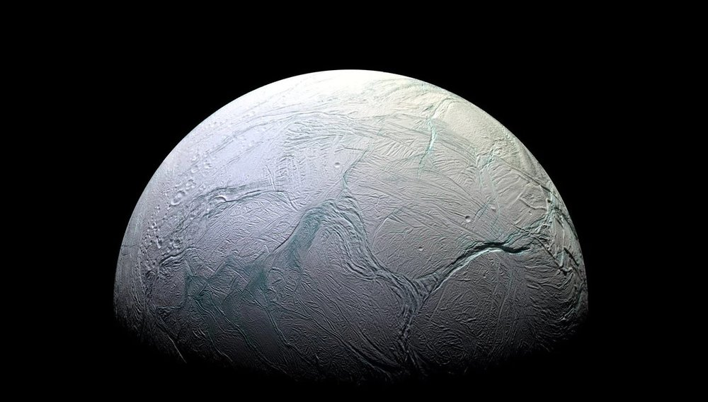 """The """"tiger stripes"""" of Enceladus, as pictured by the Cassini space probe. - Image credit:  NASA/JPL-Caltech"""