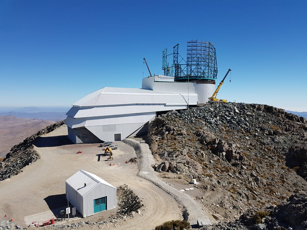 Exterior view of the Large Synoptic Survey Telescope, which is still under construction. Sublocation Cerro Pachón, Chile. - Image Credit:  LSST Project/NSF/AURA ,  CC BY-NC-SA
