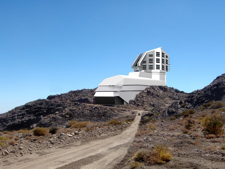 A photograph and a baseline design rendering mix, showing a view of the completed exterior building from the road leading up to the site. - Image Credit:  LSST Project/NSF/AURA ,  CC BY-NC-SA