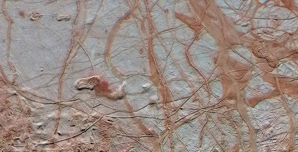 Images from NASA's Galileo spacecraft show the intricate detail of Europa's icy surface. - Image Credit:NASA/JPL-Caltech