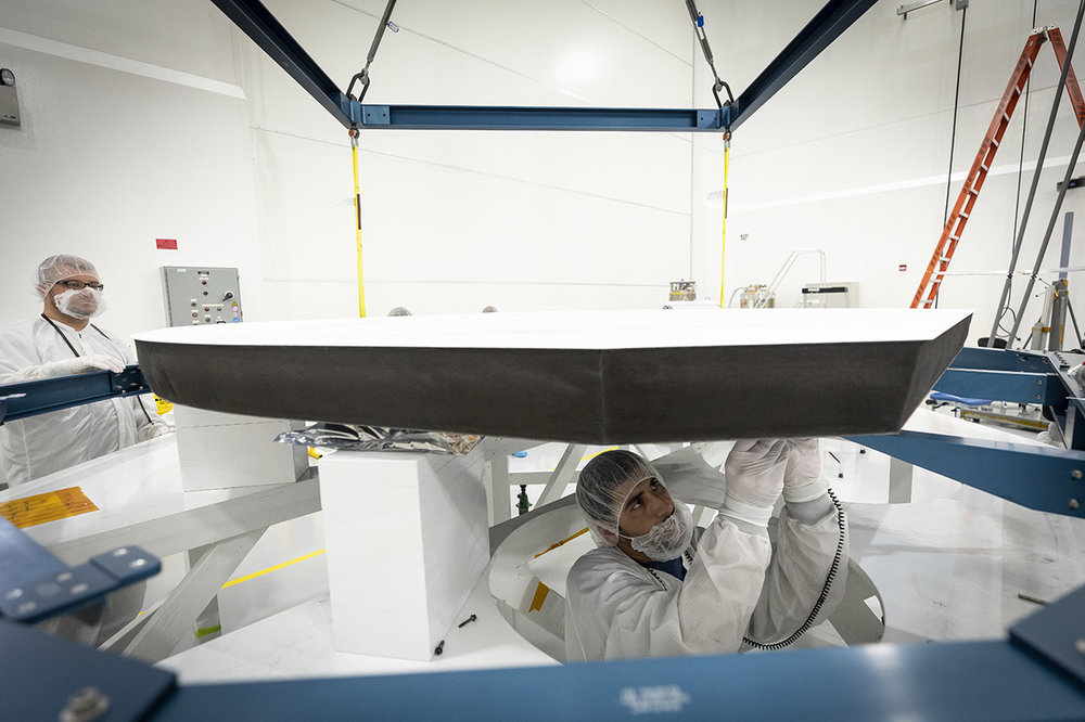 Parker Solar Probe's heat shield is made of two panels of superheated carbon-carbon composite sandwiching a lightweight 4.5-inch-thick carbon foam core. To reflect as much of the Sun's energy away from the spacecraft as possible, the Sun-facing side of the heat shield is also sprayed with a specially formulated white coating. - Image Credits: NASA/Johns Hopkins APL/Ed Whitman (Click to enlarge)