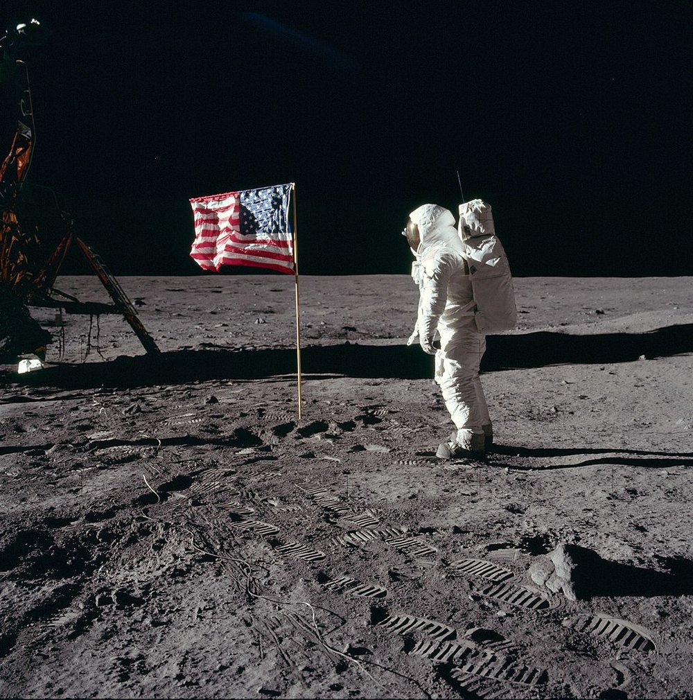 Edwin E. 'Buzz' Aldrin Jr. poses for a photograph beside the U.S. flag deployed on the moon during the Apollo 11 mission on July 20, 1969 -  Image Credit: NASA / Neil A. Armstrong via Wikimedia Commons  (click to enlarge)