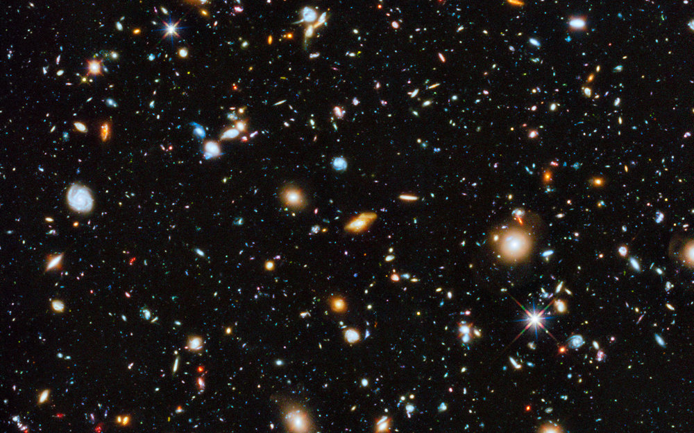 Colorful view of universe as seen by Hubble in 2014 - Image Credit:  NASA, ESA, H. Teplitz and M. Rafelski (IPAC/Caltech), A. Koekemoer (STScI), R. Windhorst (Arizona State University), and Z. Levay (STScI)