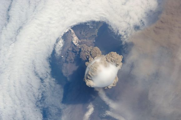 Image of the Sarychev volcano (in Russia's Kuril Islands) caught during an early stage of eruption on June 12, 2009. Taken by astronauts aboard the International Space Station. - Image Credit: NASA