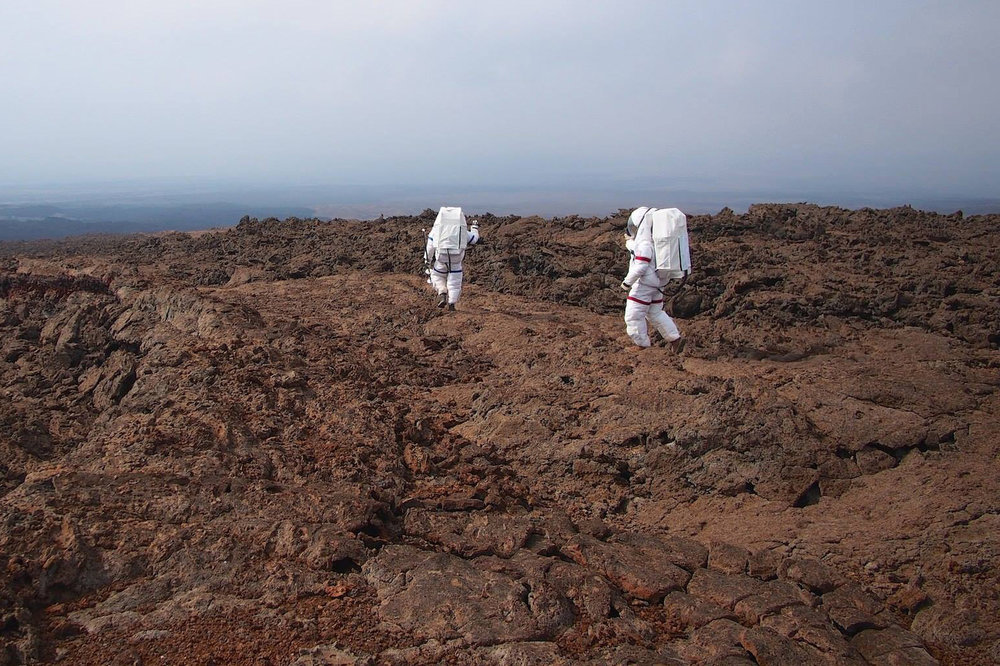 Two members of Mission V conducting a geological study using mock space suits. - Image Credit: NASA/Hi-SEAS