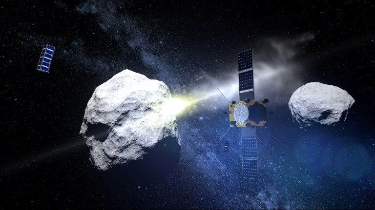 Artit's impression of the Double Asteroid Redirection Test (DART) mission and the asteroid system Didymos. - Image Credit: ESA/AFP