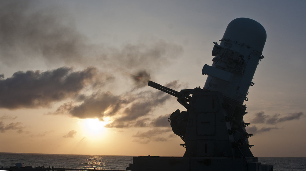 The MK 15 Phalanx close-in weapons system, on the USS Reuben James guided-missile frigate, fires during an exercise. - Image Credit:  Flickr/US Pacific Fleet ,  CC BY-NC
