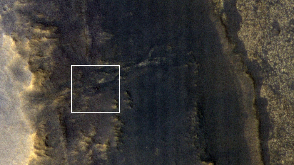 NASA's Opportunity rover appears as a blip in the center of this square. This image taken by HiRISE, a high-resolution camera onboard NASA's Mars Reconnaissance Orbiter, shows the dust storm over Perseverance Valley has substantially cleared. - Image Credit: NASA/JPL-Caltech/Univ. of Arizona