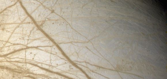 The grooved surface of Jupiter's moon Europa, captured by the Galileo spacecraft. - Image Credit: By NASA [Public domain], via Wikimedia Commons