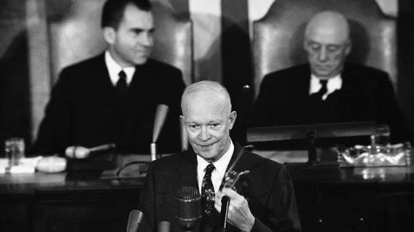 President Eisenhower addressing a joint session of Congress in 1958. Behind the president are Vice President Richard Nixon, left, and Speaker of the House Sam Rayburn, right.- Image Credit: NASA