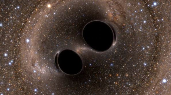 Black hole collision and merger releasing gravitational waves. - Image Credit: LIGO,  CC BY-SA