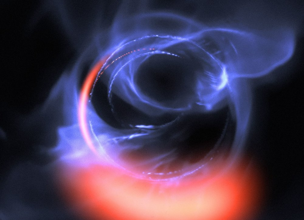 This visualisation uses data from simulations of orbital motions of gas swirling around at about 30% of the speed of light on a circular orbit around the black hole. - Image Credit: ESO/Gravity Consortium/L. Calçada