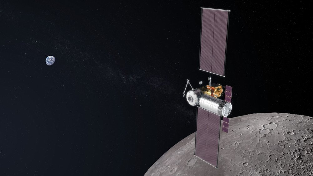 In this artist's concept image, the Gateway is shown mid-assembly. The first logistics module carrying cargo and other goods is docked to the spaceship as it orbits the Moon. - Image Credits: NASA