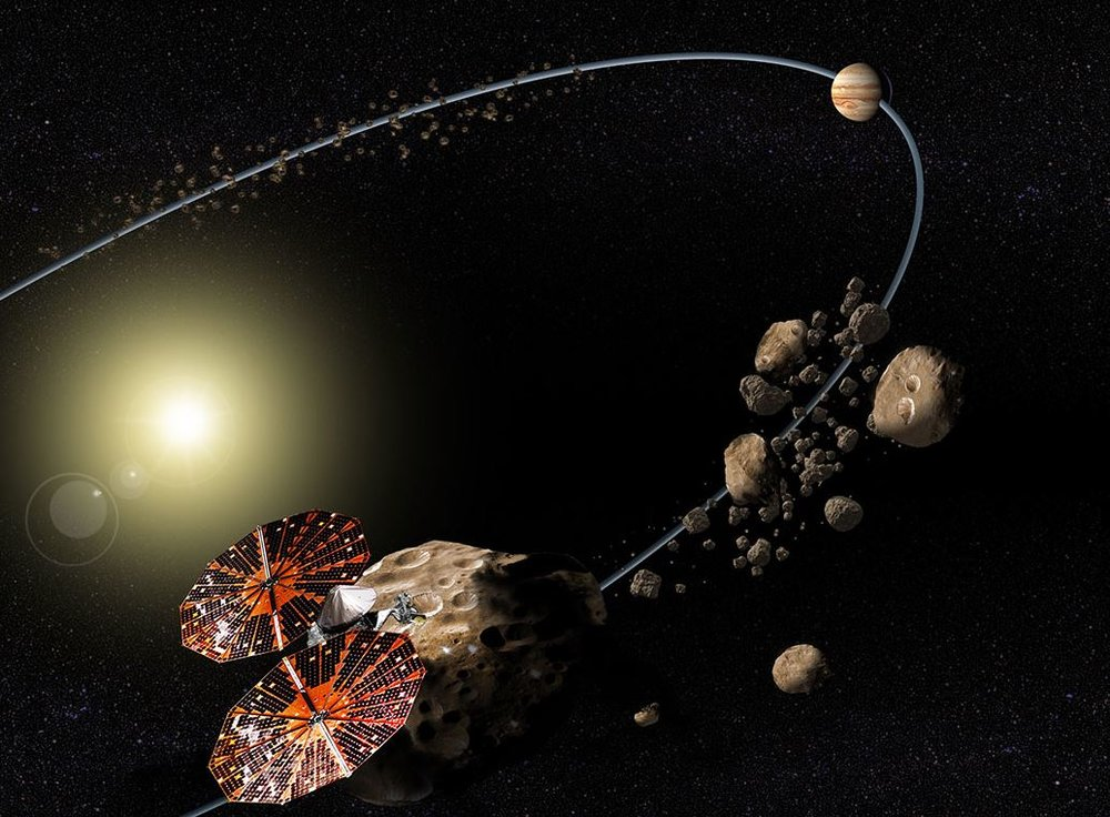 Conceptual image of the Lucy mission to the Trojan asteroids. - Image Credit: NASA/SwRI