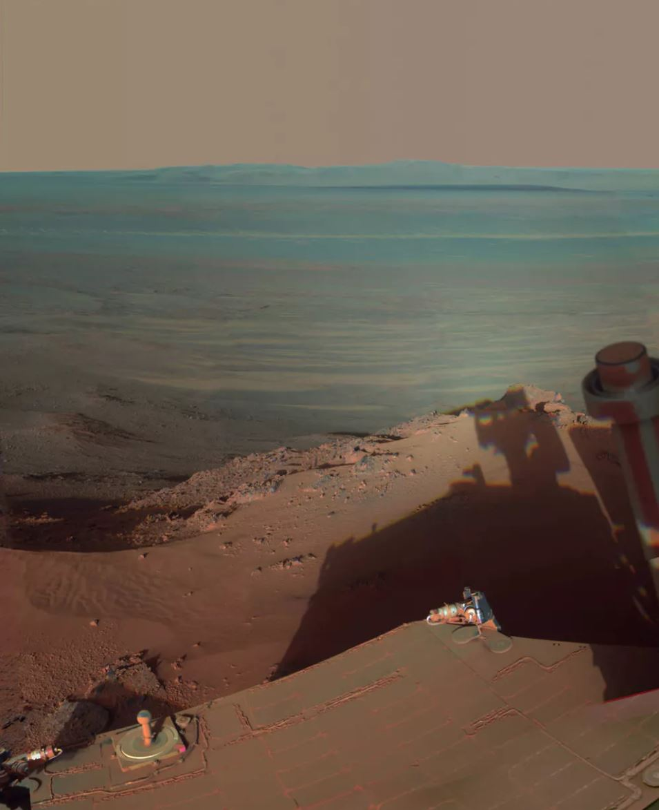NASA's Mars rover Opportunity catches its own late-afternoon shadow in this dramatically lit view eastward across Endeavour Crater on Mars. - Image Credit:  NASA/JPL-Caltech/Cornell/Arizona State Univ.