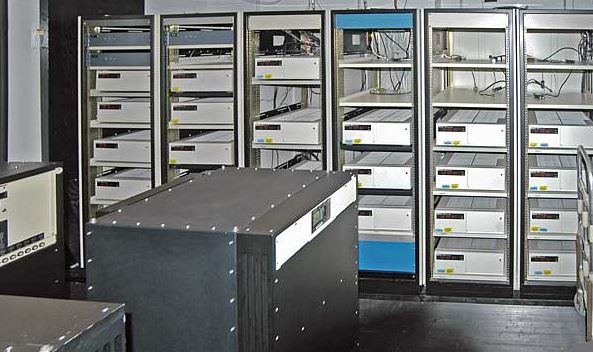 Atomic clocks have been in use for decades. This image shows banks of atomic clocks at the US Naval Observatory, used to define the time standard for the US Dept. of Defense. - Image Credit:  US Naval Observatory via Wikimedia Commons