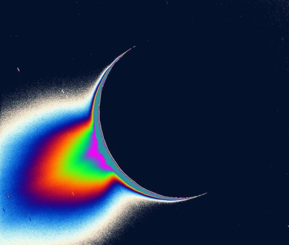 An image of Saturn's moon Enceladus backlit by the Sun, taken by the Cassini mission. The false color tail shows jets of icy particles and water that spray into space from an ocean that lies deep below the moon's icy surface. Future missions could search for the ingredients for life in an ocean on an icy moon like Enceladus. - Image Credit: NASA/JPL/Space Science Institute