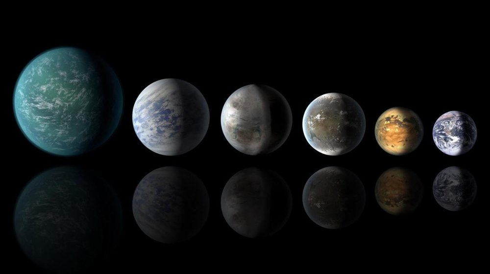 Artist's concept of Earth-like exoplanets, which (according to new research) need to strike the careful balance between water and landmass. - Image Credits: NASA