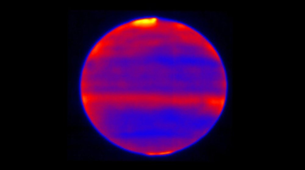 Scientists used red, blue and yellow to infuse this infrared image of Jupiter's atmosphere (red and yellow indicate the hotter regions), which was recorded by the Cooled Mid-Infrared Camera and Spectrograph (COMICS) at the Subaru Telescope on the summit of Mauna Kea, Hawaii on Jan. 12, 2017. - Image Credits: NAOJ and NASA/JPL-Caltech
