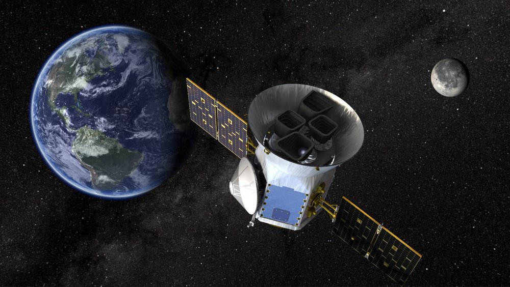 NASA's Transiting Exoplanet Survey Satellite (TESS), shown here in a conceptual illustration, will identify exoplanets orbiting the brightest stars just outside our solar system. - Image Credit: NASA's Goddard Space Flight Center