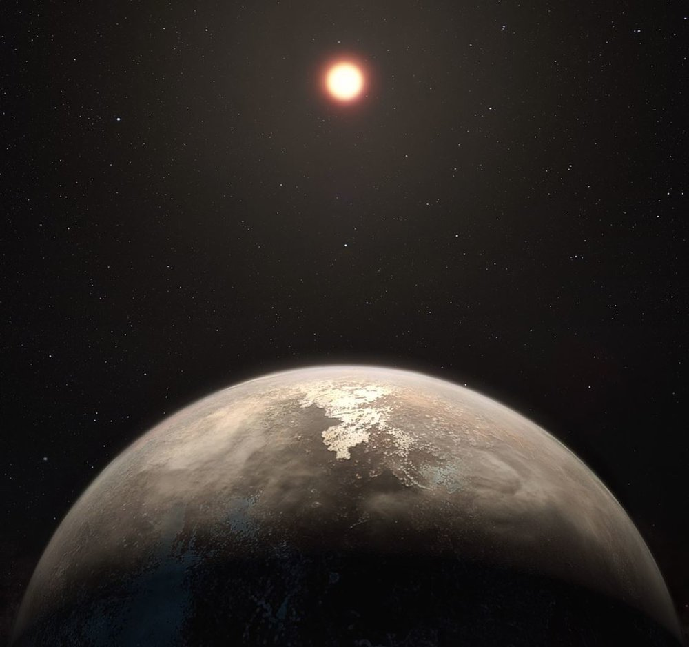 Artist's impression of a habitable exoplanet orbiting a red dwarf star. The habitability of the planets of red dwarf stars is conjectural - Image Credit ESO/M. Kornmesser