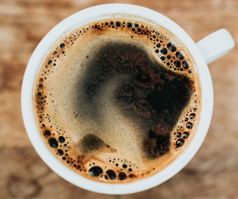 There's good evidence drinking coffee before exercise can marginally improve your performance. - Image Credit:  Nathan Dumlao via Unsplash