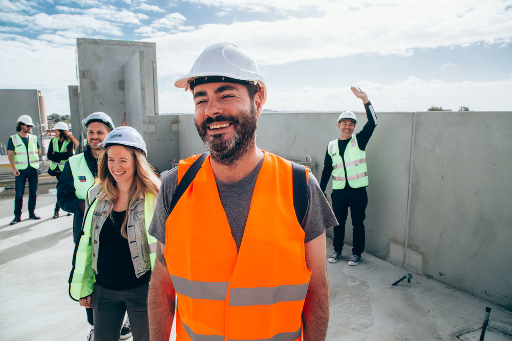 Jason participating in a Nightingale 1 resident tour during the projects's construction phase