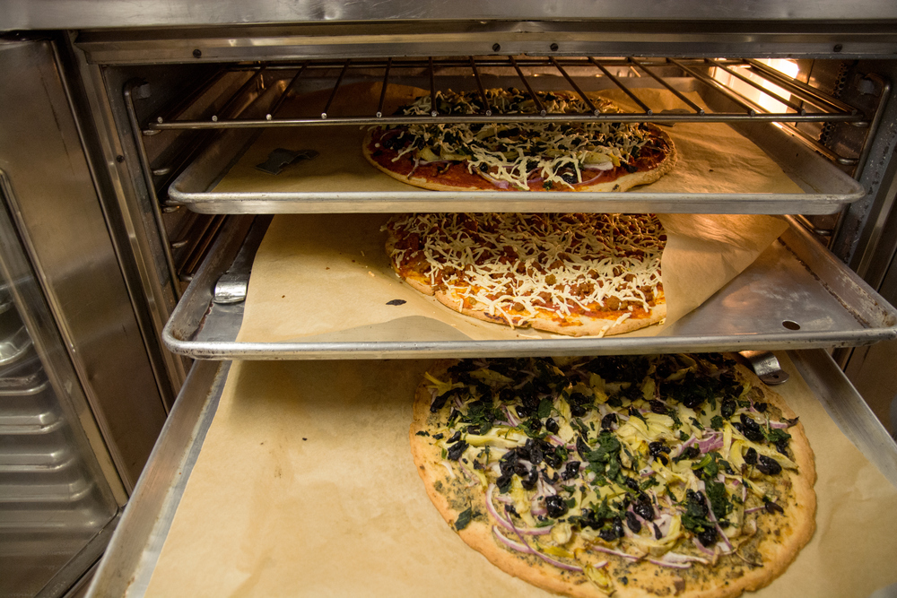 A delicious lunch of vegan, gluten-free pizza, made in Earthly Gourmet's on-stie commercial kitchen which houses the headquarters of gluten-free bakery Sift.  All ingredients on the pizzas are ones that Earthly Gourmet distribute.