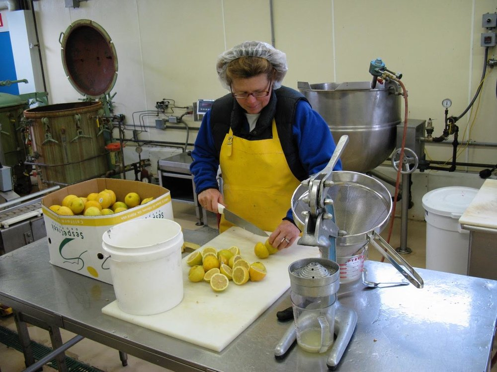Carol prepping lemons for the juicer.